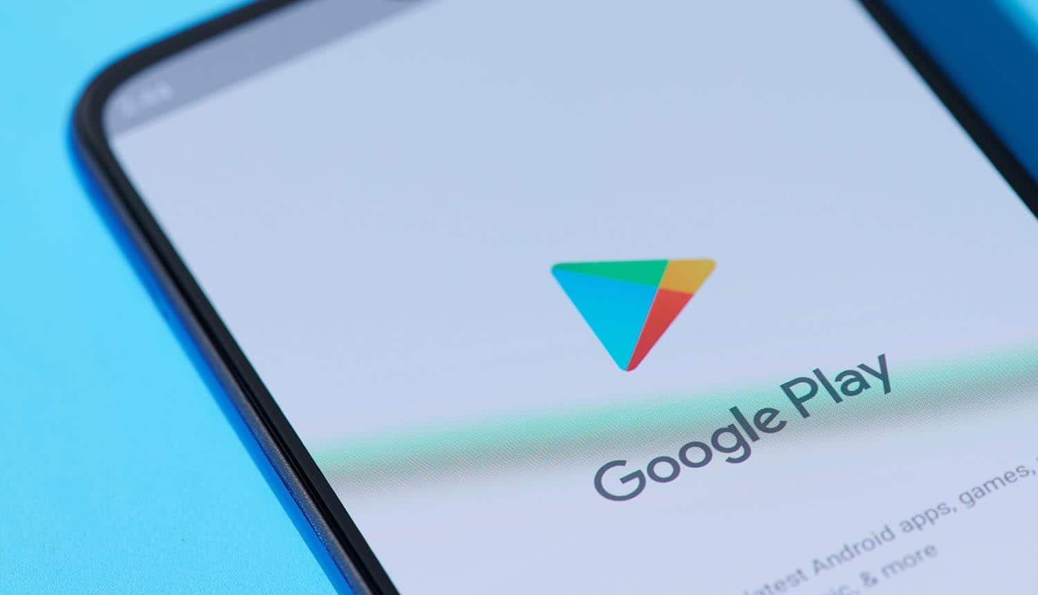 Google Play Store on smartphone screen showing ban on stalkerware apps for user tracking
