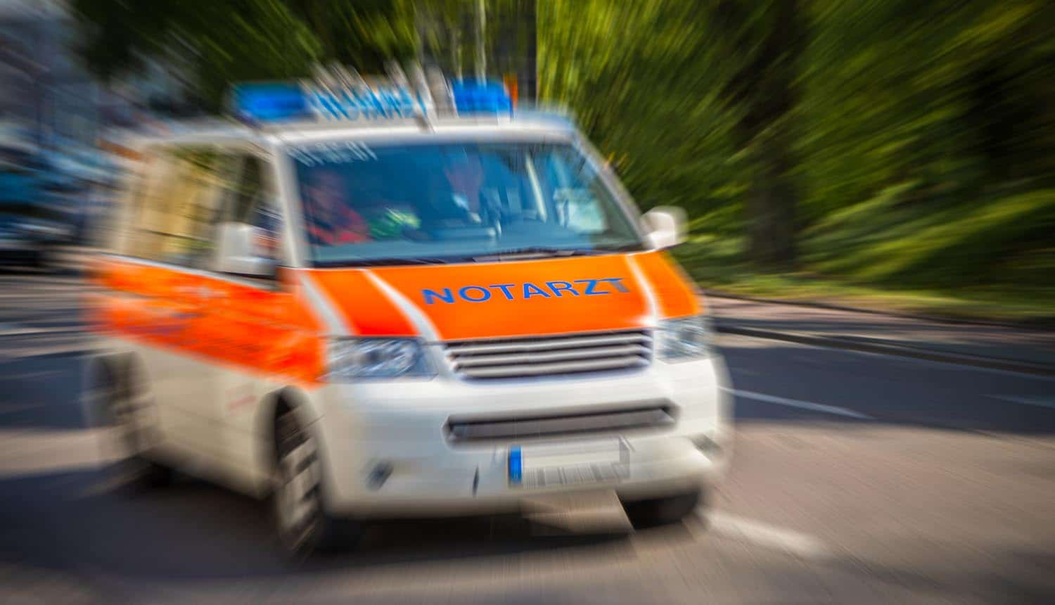 German emergency ambulance car drives on the street showing ransomware attack on German hospital