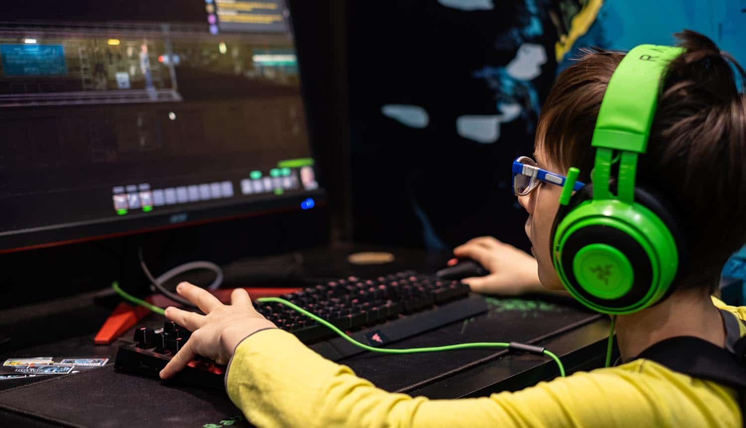 Teenager testing a new computer game with Razer equipment showing data leak of cloud databases