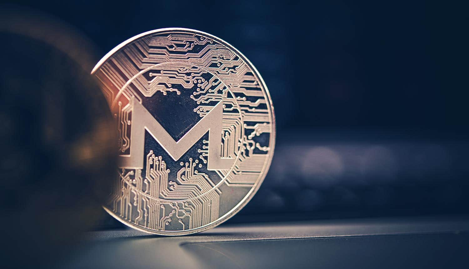 Close up Monero cryptocurrency coin showing tracking of cryptocurrency transactions