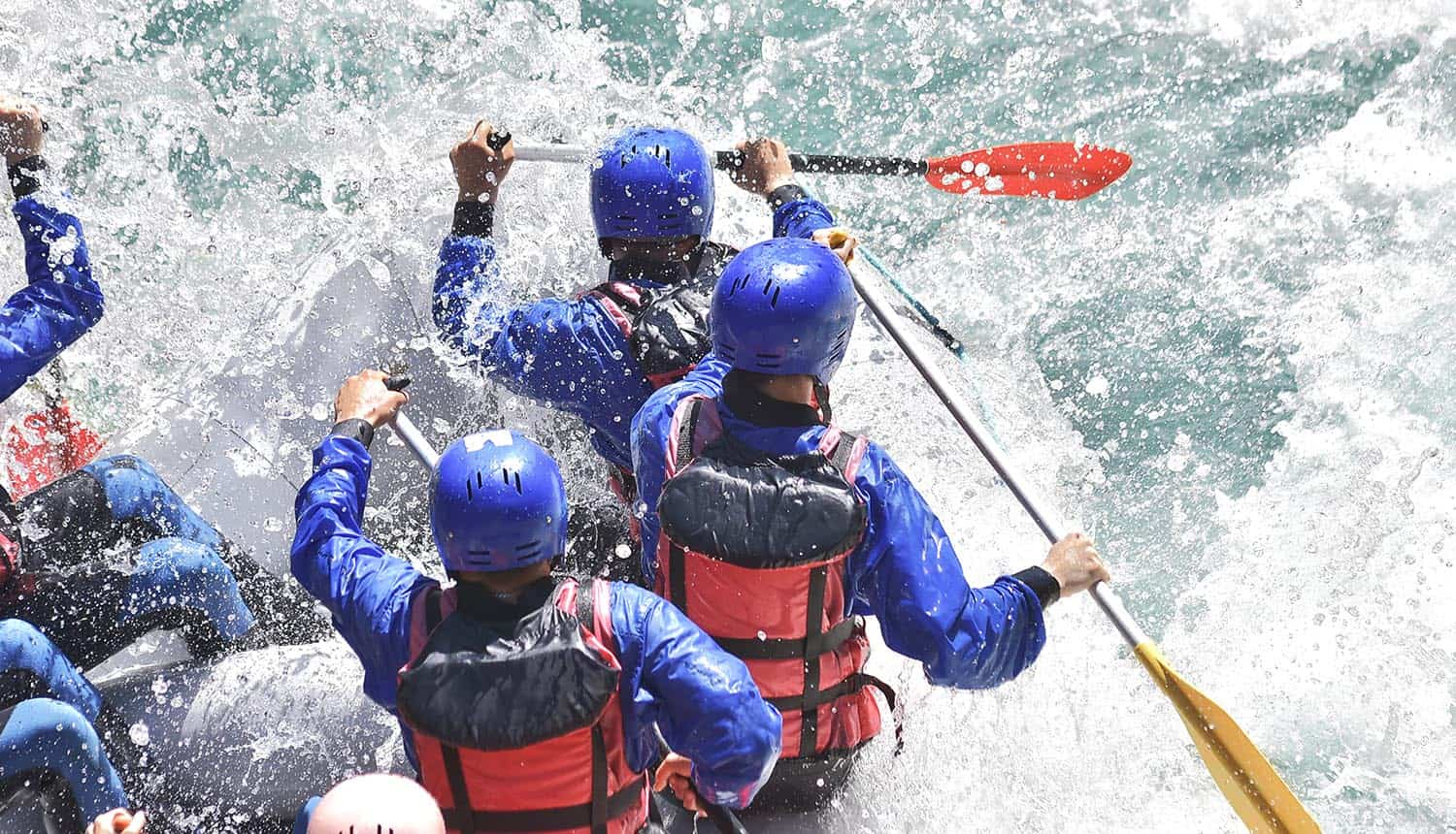 Rafting team splashing the waves showing privacy challenges in a new world