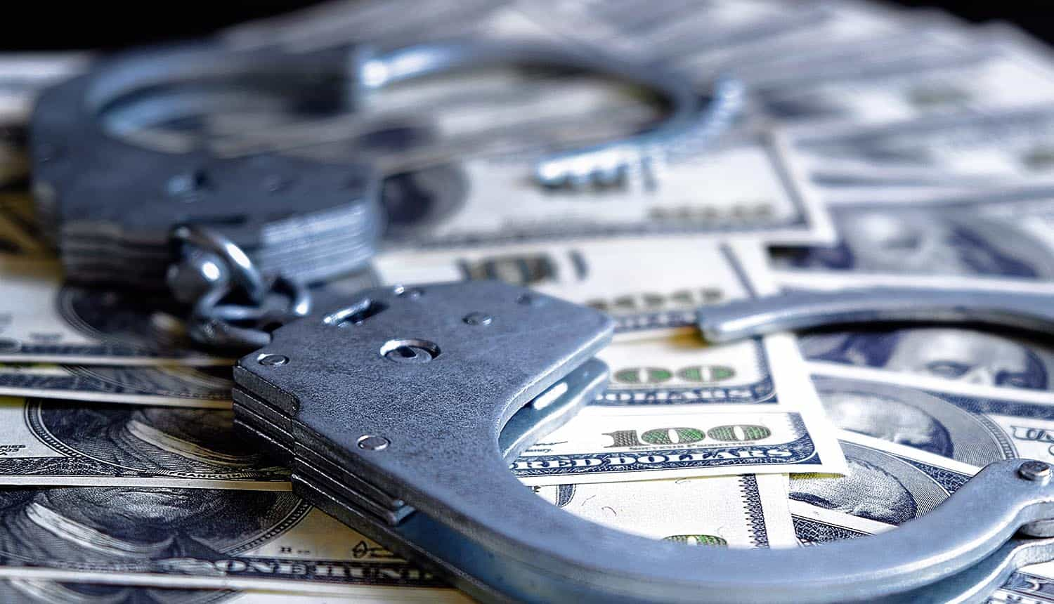 Money and handcuffs showing US Treasury warning of ransomware payments