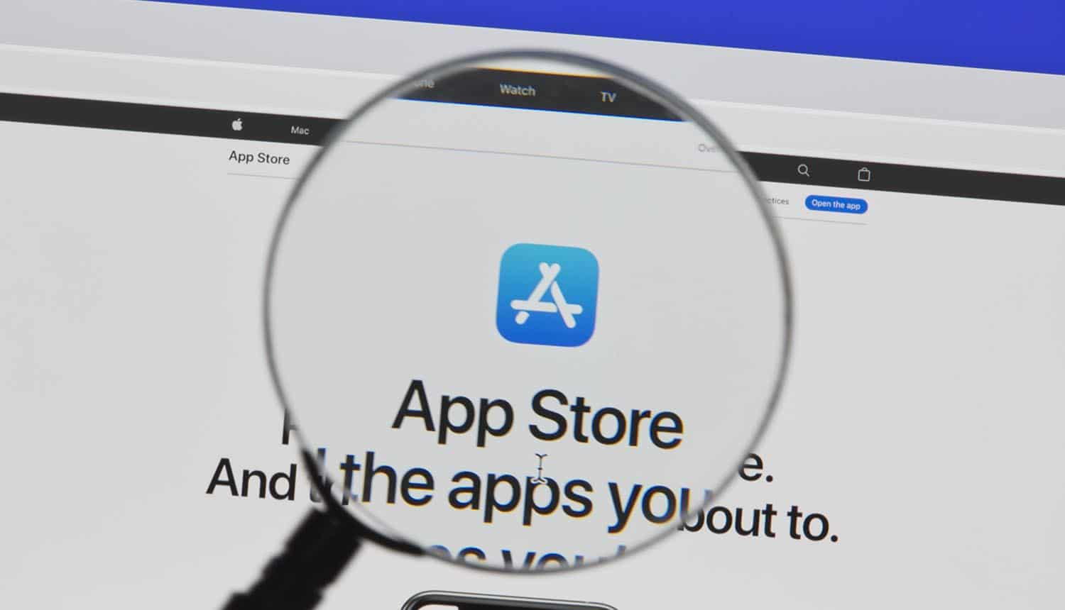 Closeup of Apple App Store website under a magnifying glass showing focus on security and privacy