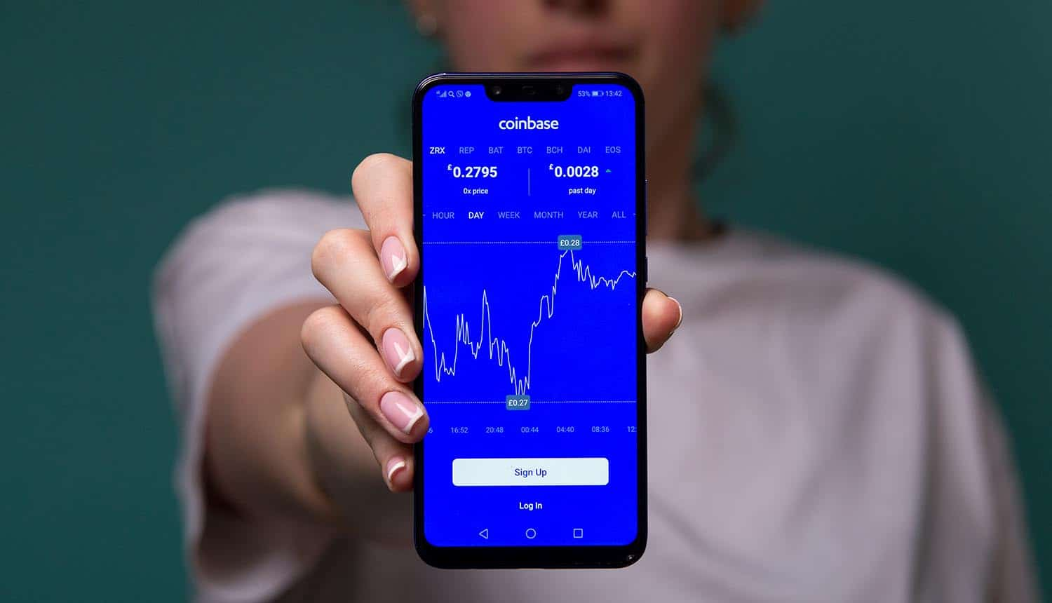Coinbase on mobile phone showing Coinbase transparency report with information requests from US law enforcement agencies