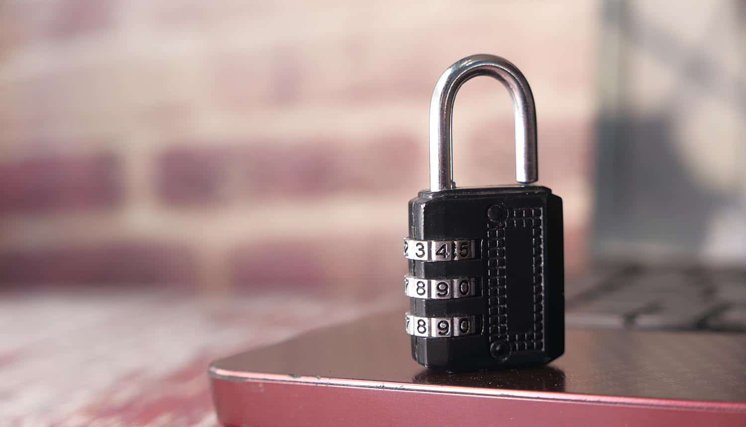 Padlock on laptop for cybersecurity