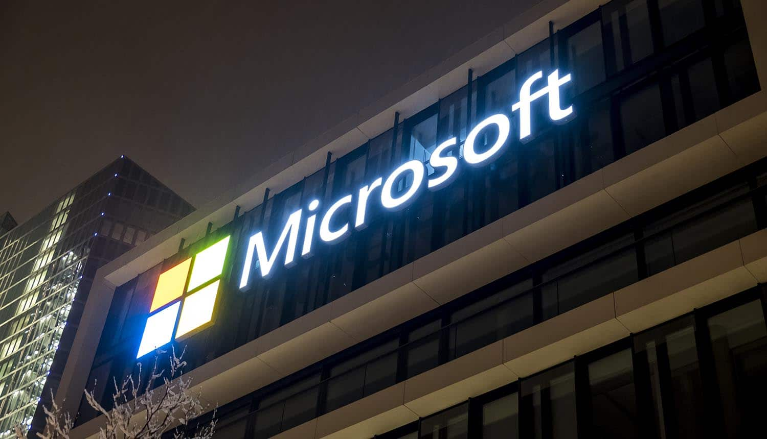 Microsoft logo on building showing warning that Zerologon vulnerability is used for cyber attacks