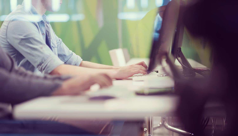Employees working on computer taking part in phishing awareness training
