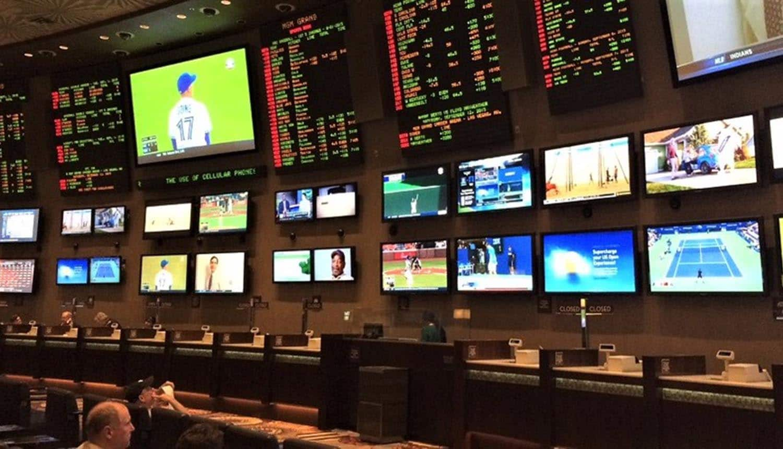 Sports screens on a wall