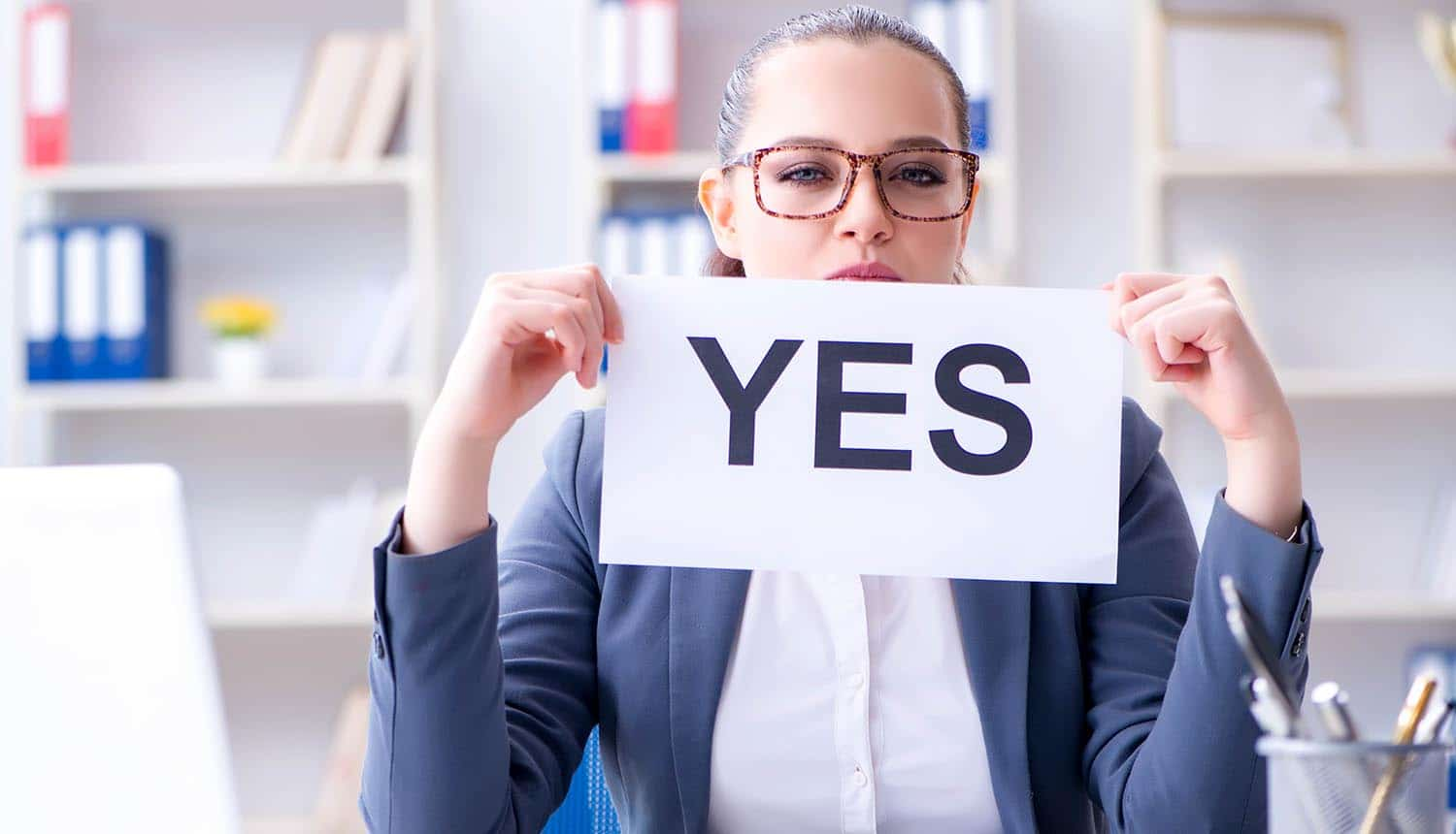 Businesswoman holding up Yes message showing privacy consent