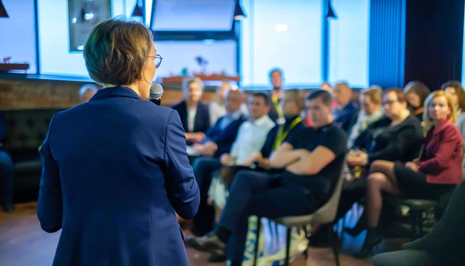 Female presenter speaks to audiences at privacy training