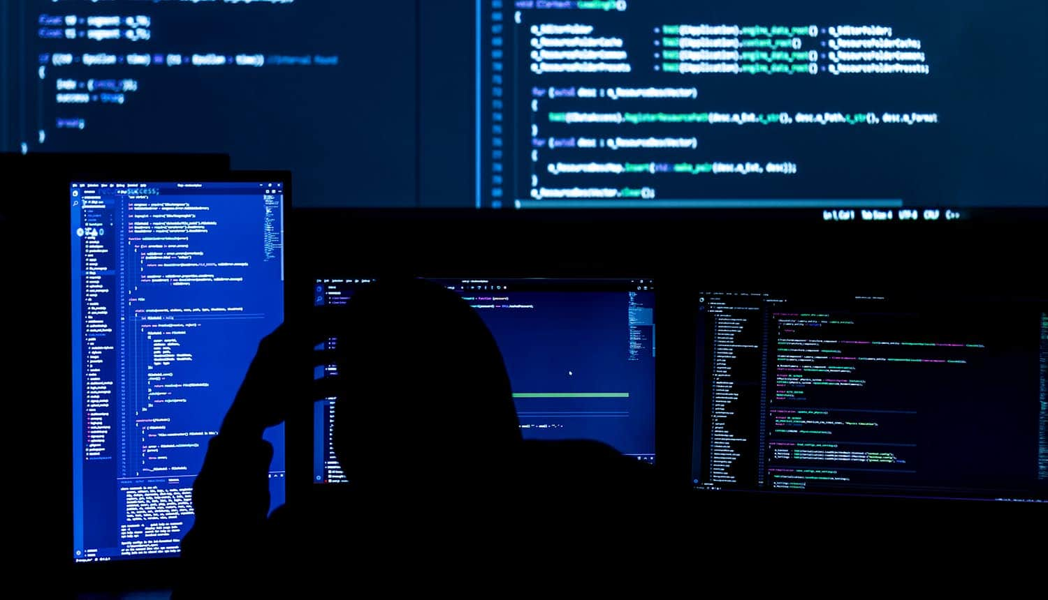 Software developer working on code showing issue with software security
