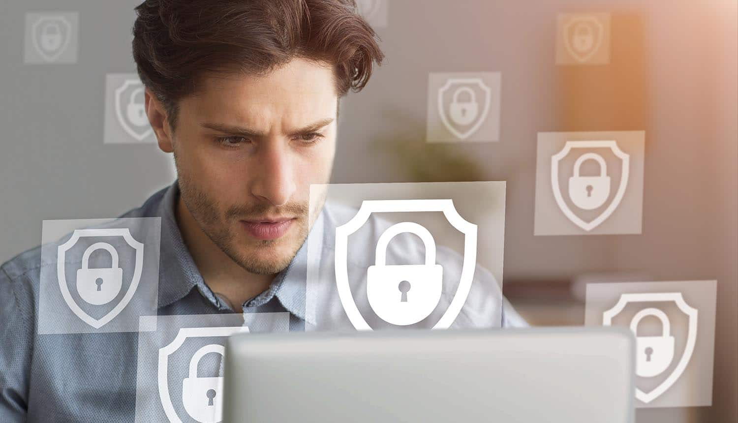 Business project, data Young man works at laptop with images of locks