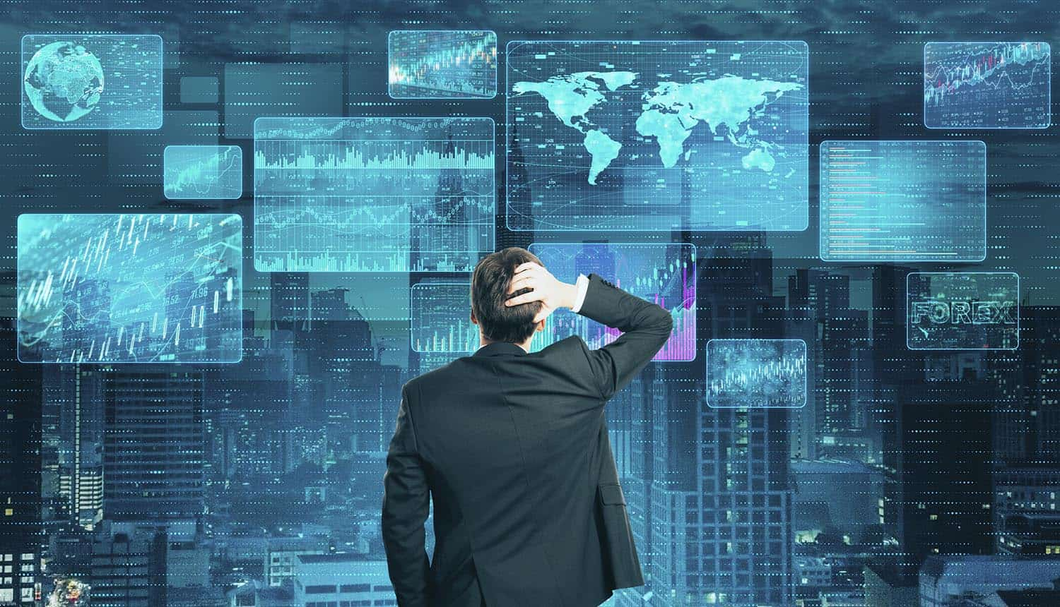 Businessman looking at glowing virtual screen showing need for modern detection and response