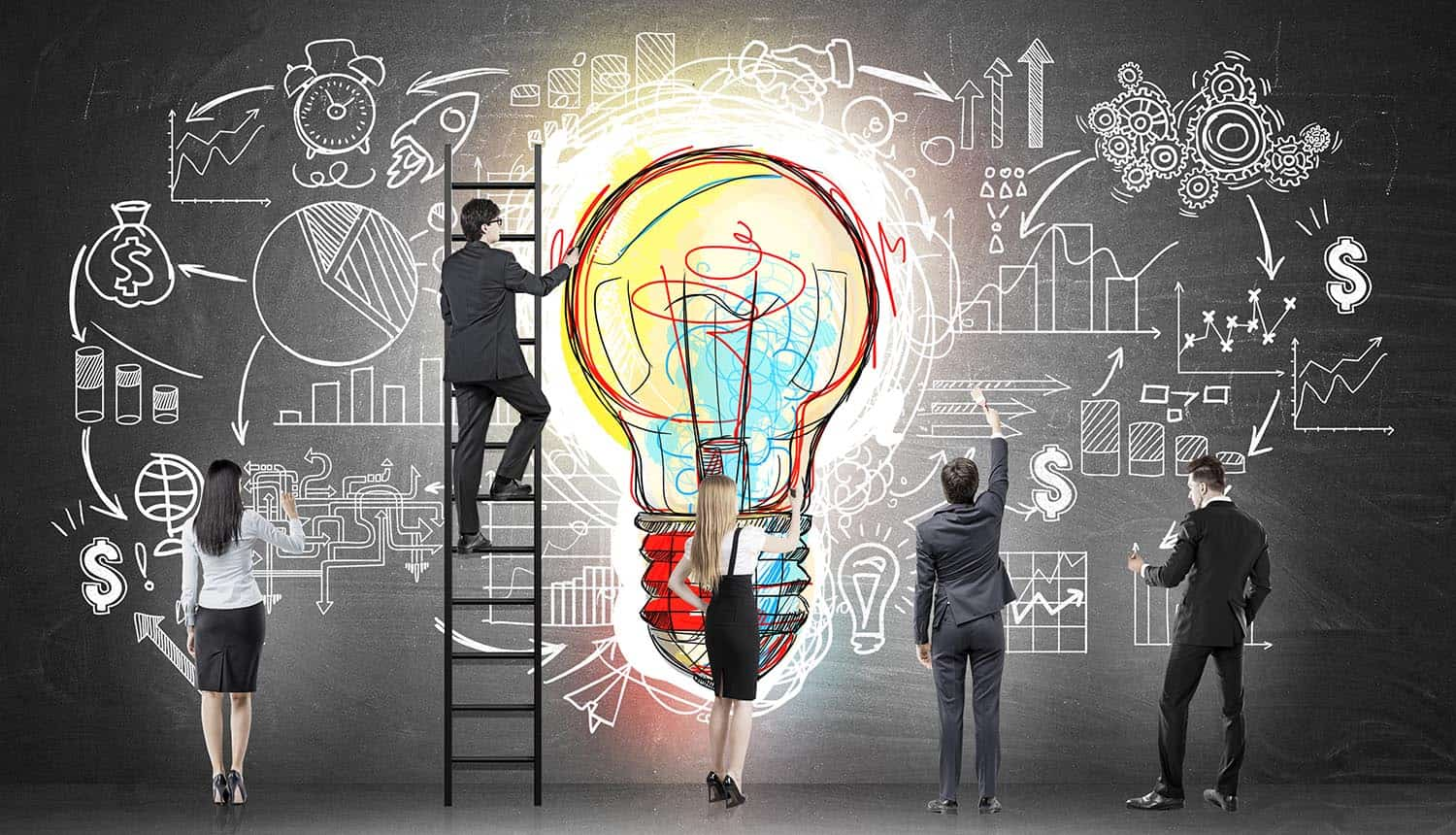Business team near blackboard with colorful light bulb showing complexity of patents and intellectual property