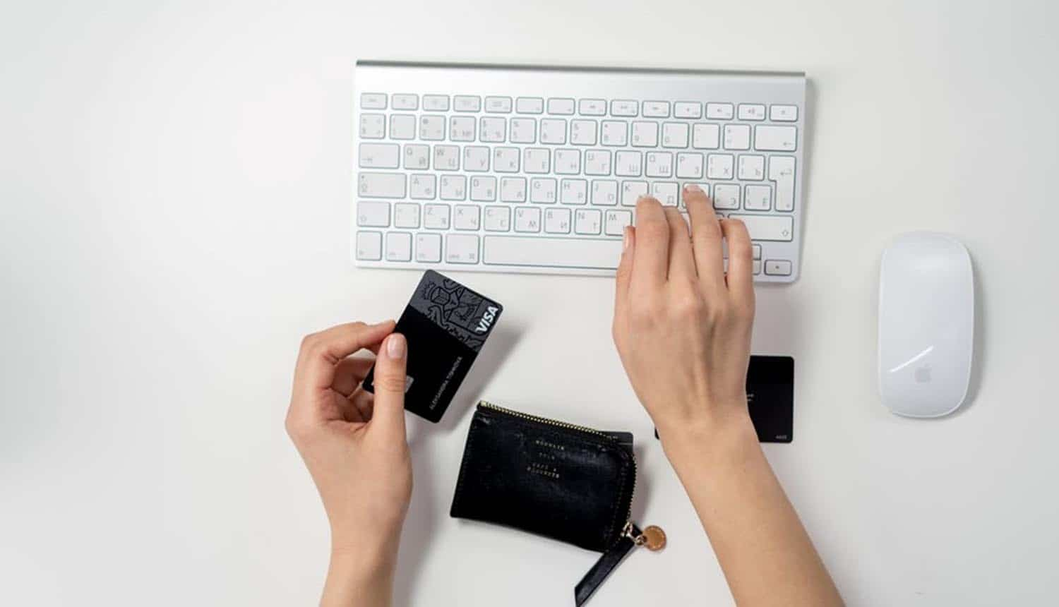 Woman typing credit card number using keyboard