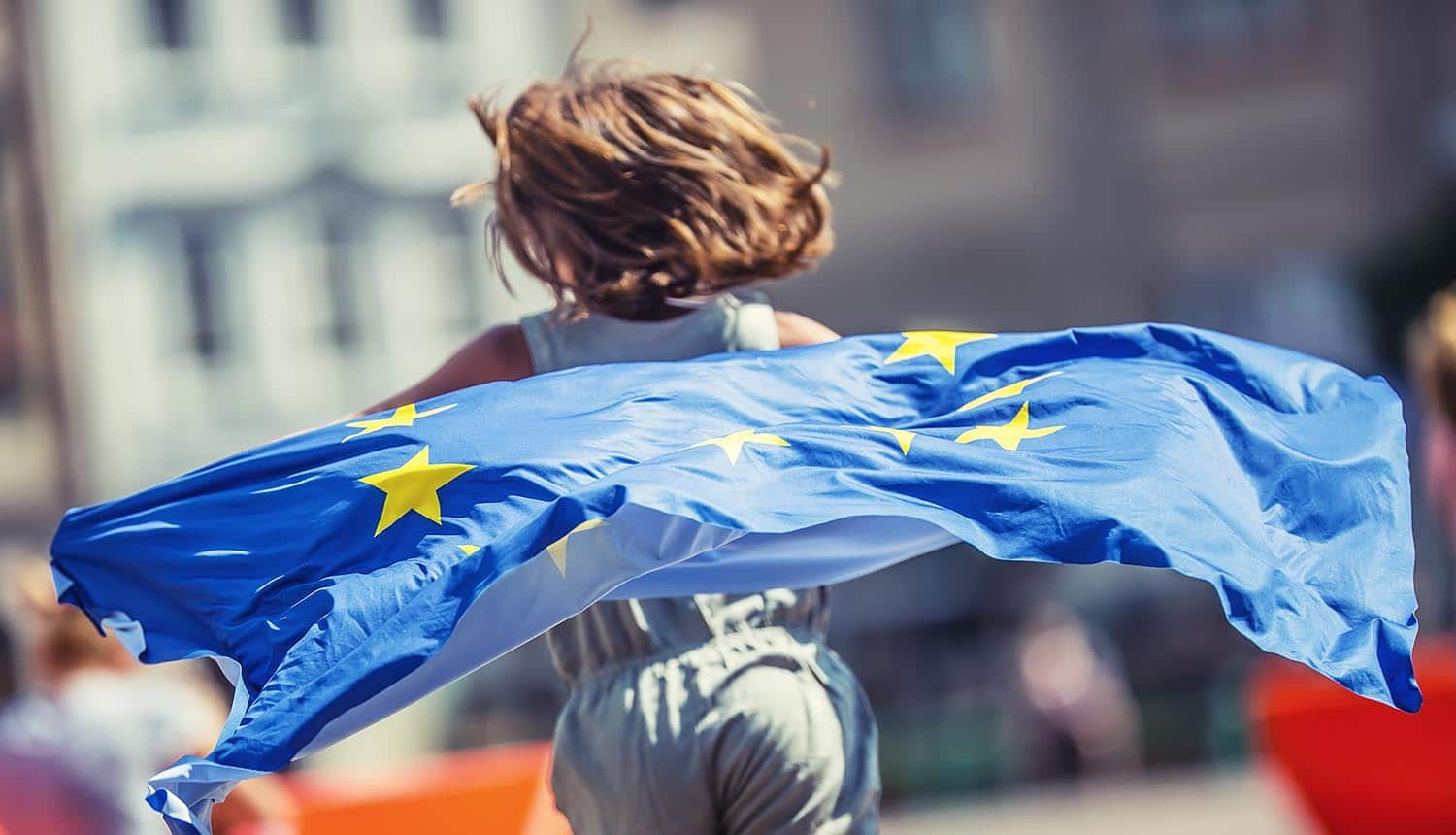 Girl with EU flag of running away from camera showing moving UK users away from EU privacy rules post Brexit