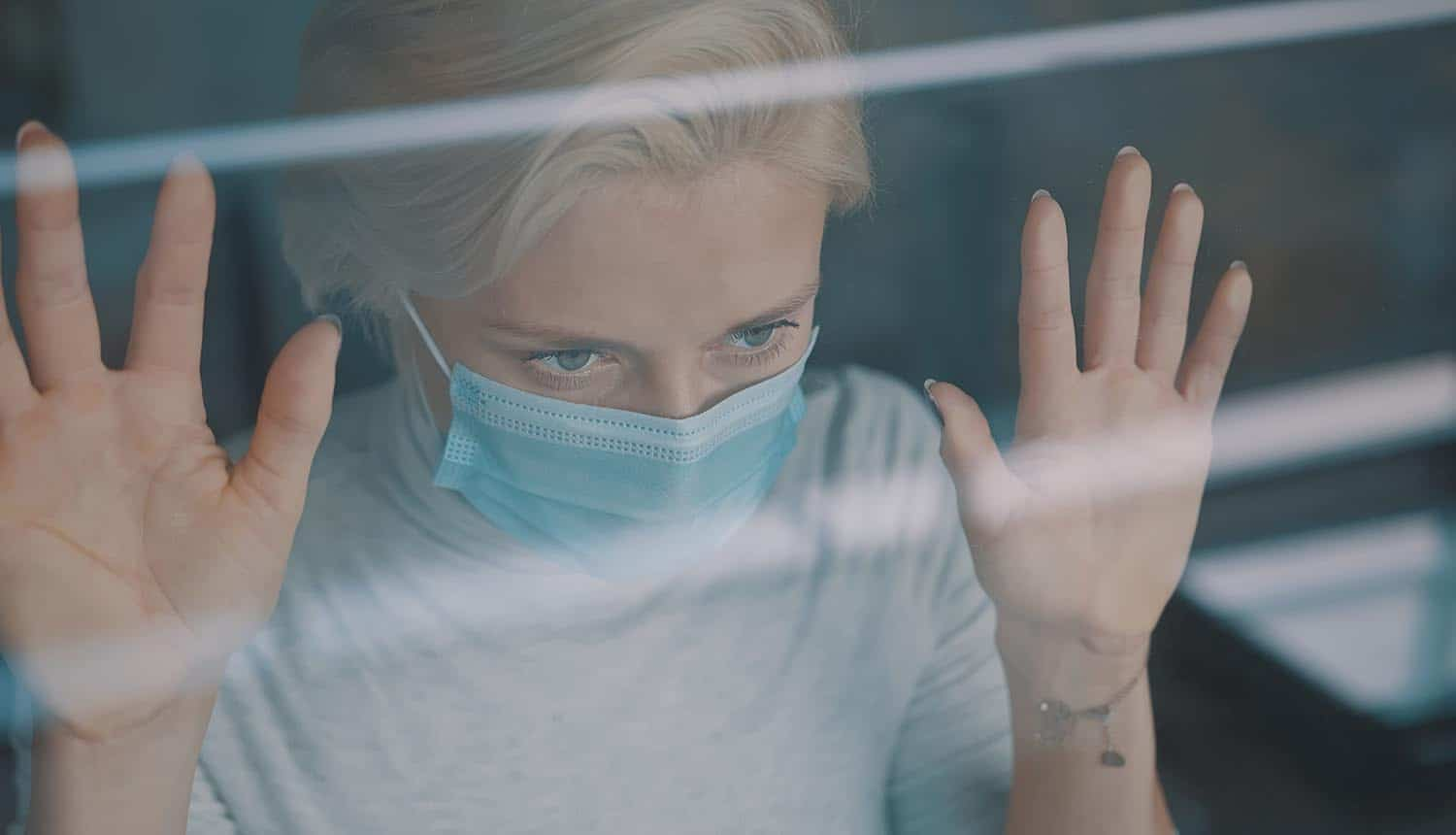 Young anxious woman with face mask showing concern over federal database for COVID-19 vaccine