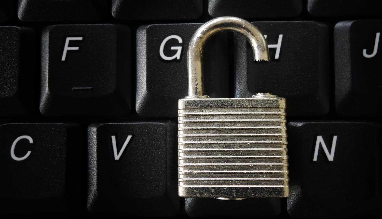 Broken lock on a computer keyboard showing data leak of VPN credentials