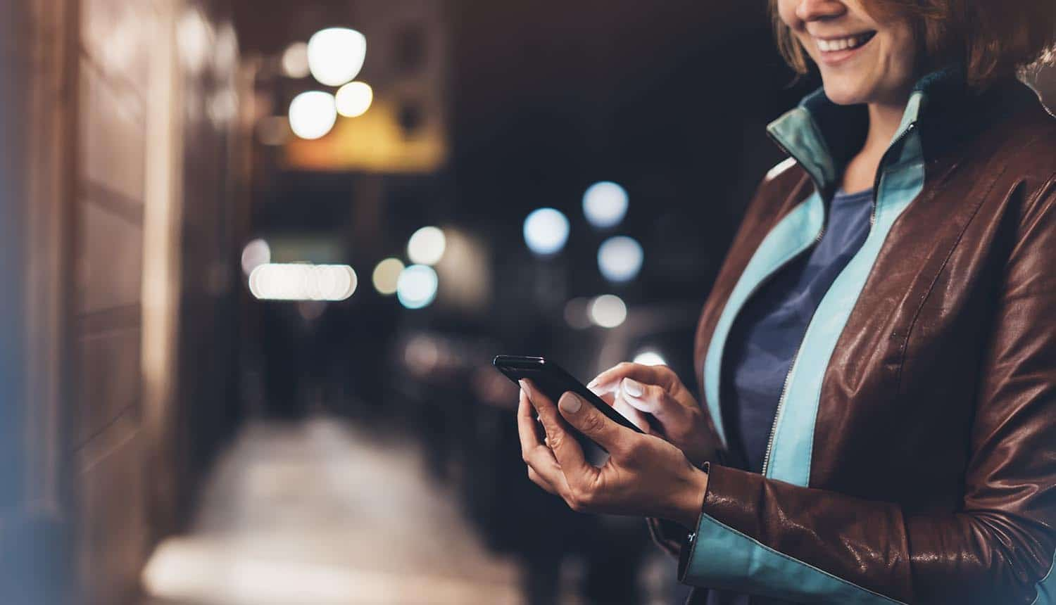 Woman smile and point finger on mobile app showing cyber threats during holiday shopping
