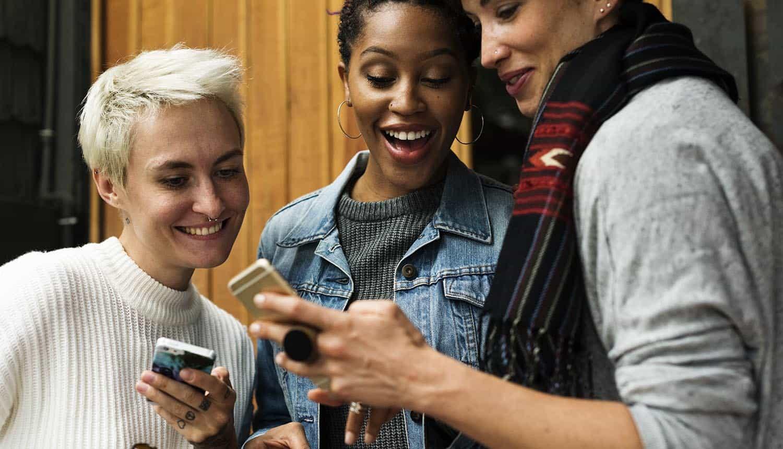 Women using mobile phone for online shopping