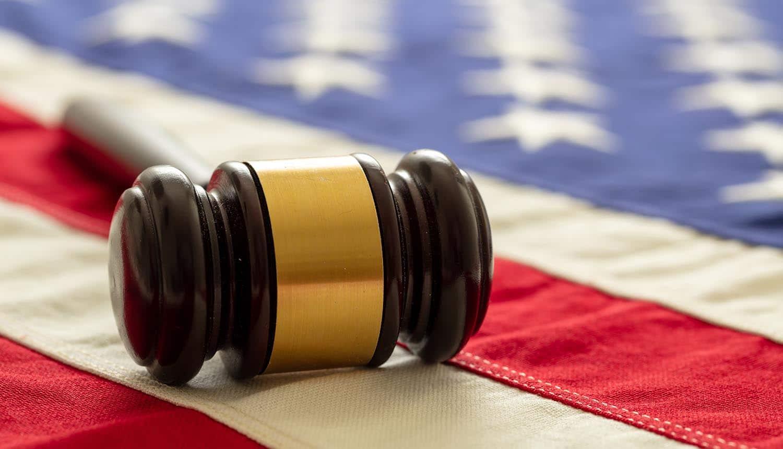 Judge gavel on US flag showing implications of CFAA in Van Buren case