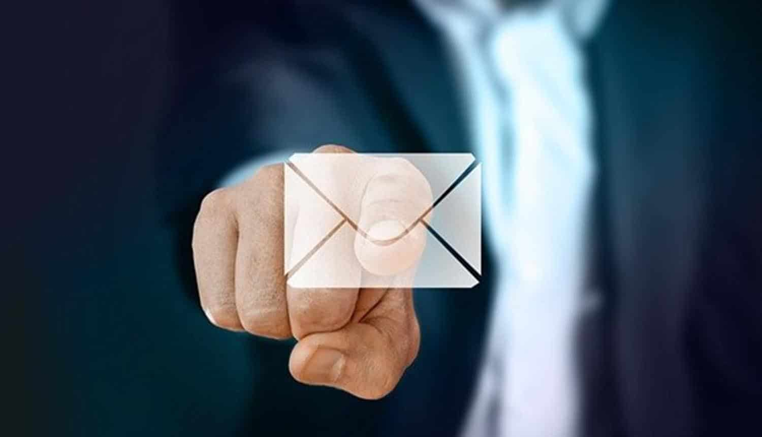 Man pointing finger at email icon