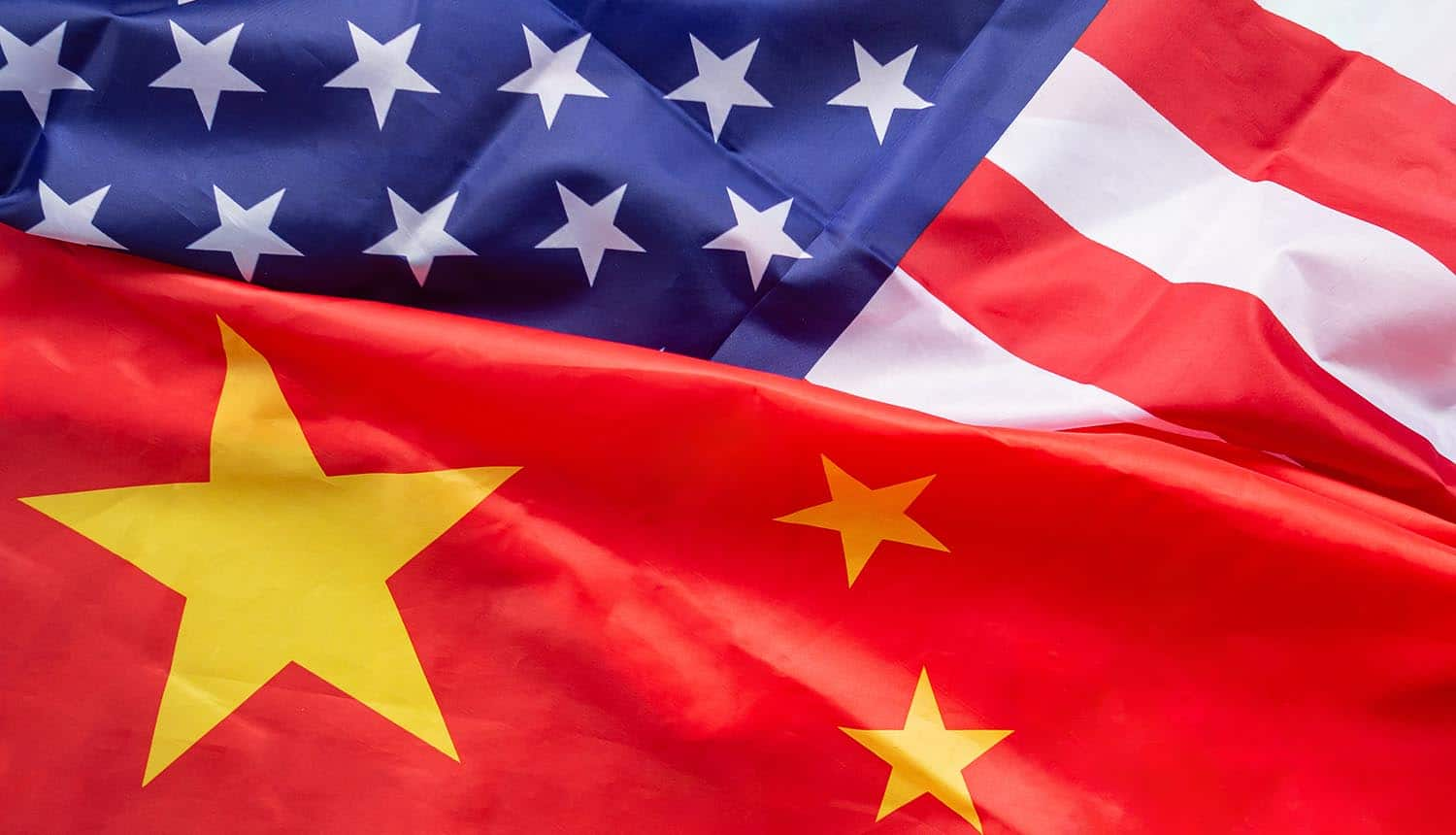 Top view of American flag and China flag together showing threat of data theft