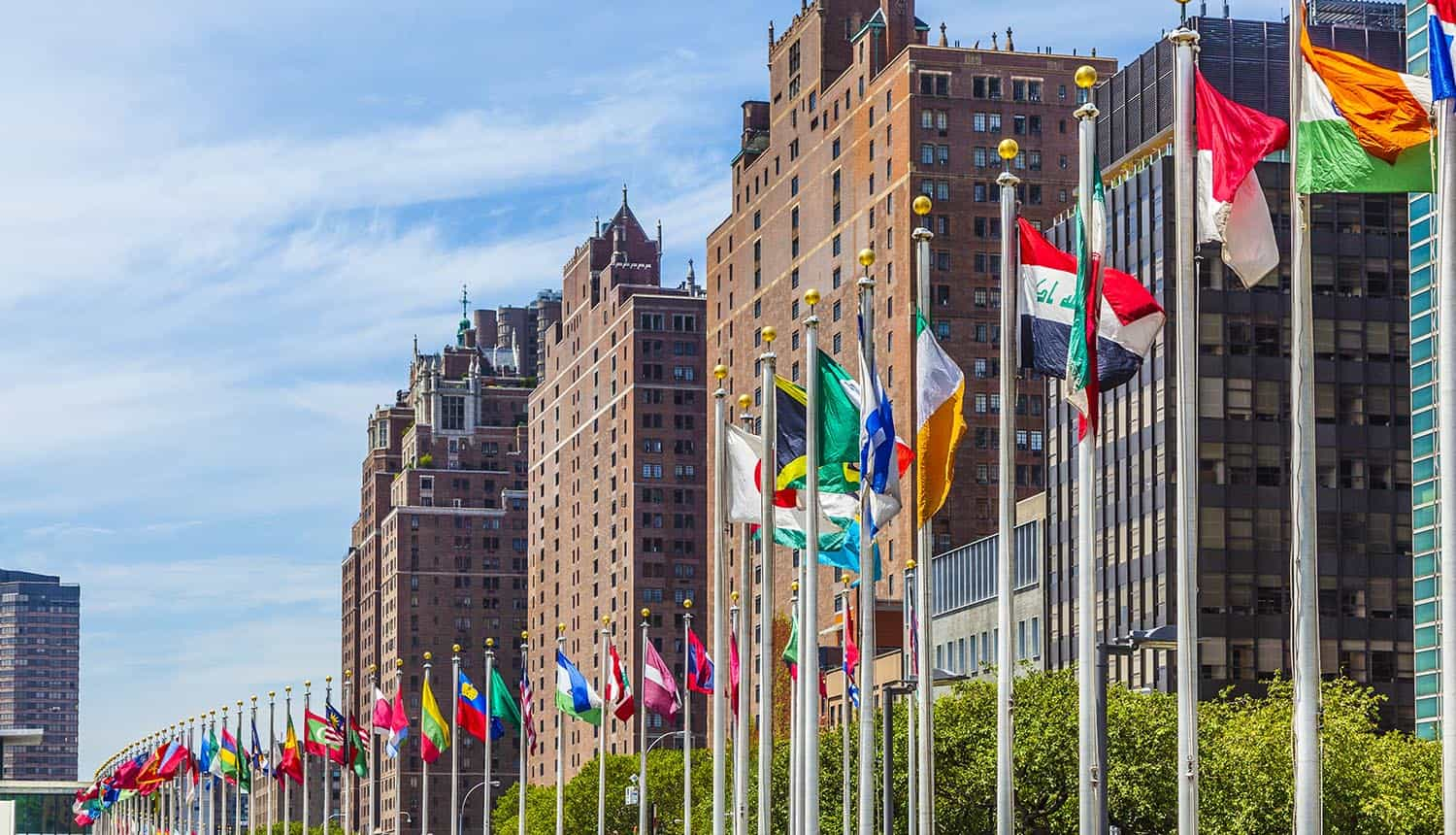 United Nations Headquarters with member flags showing impact of data breach of employee records