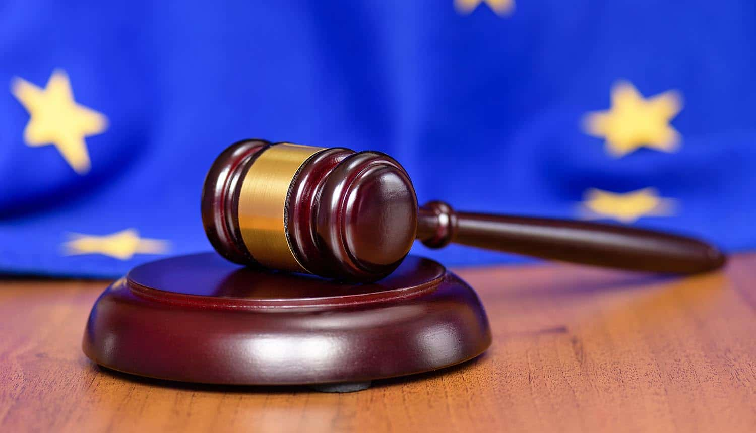 EU flag on the background of the judges gavel showing GDPR fines