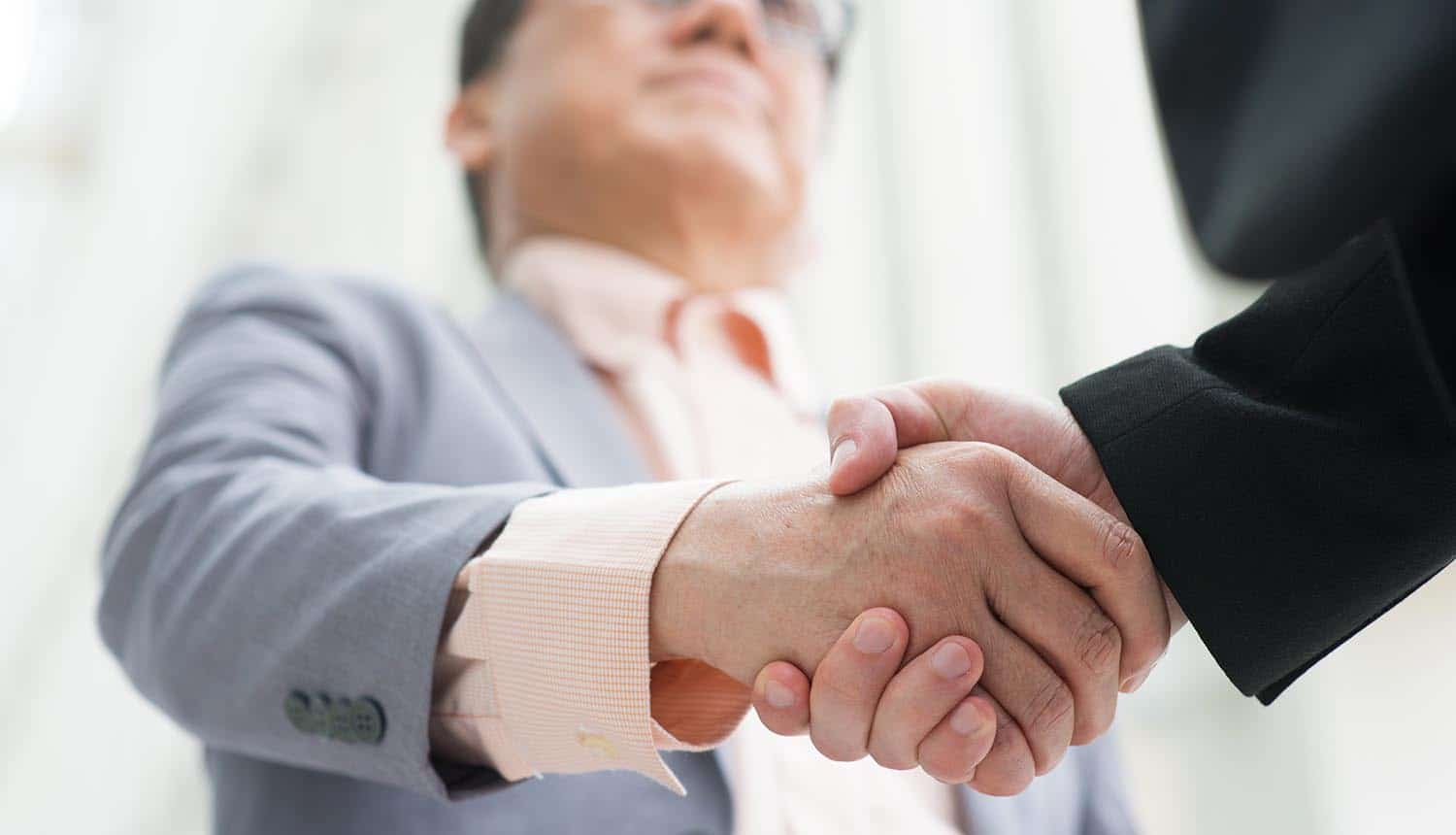 Employee shaking hands with executive