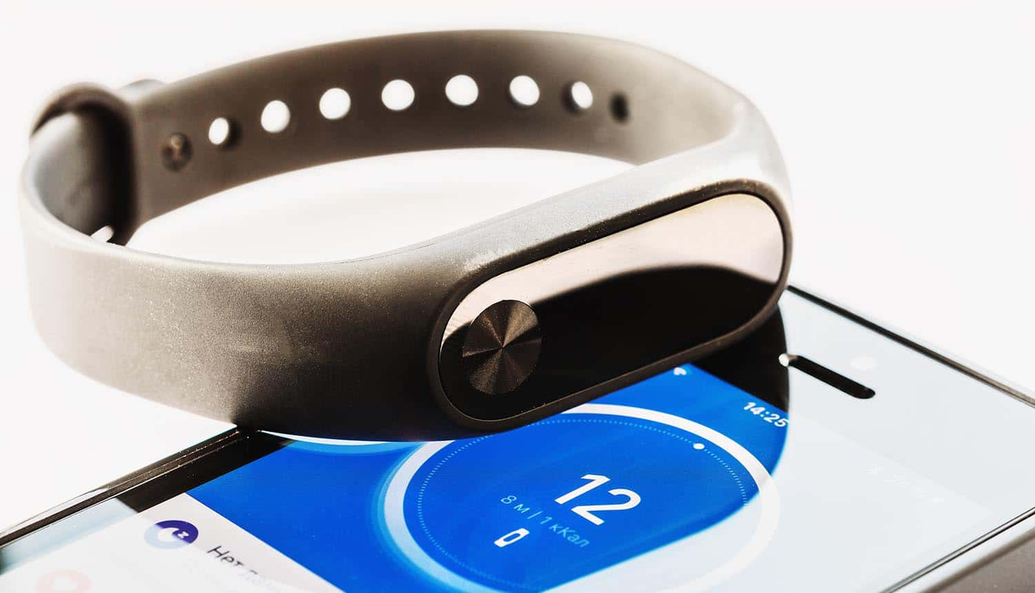 Fitness tracker on mobile phone showing health data privacy with Google acquisition of Fitbit