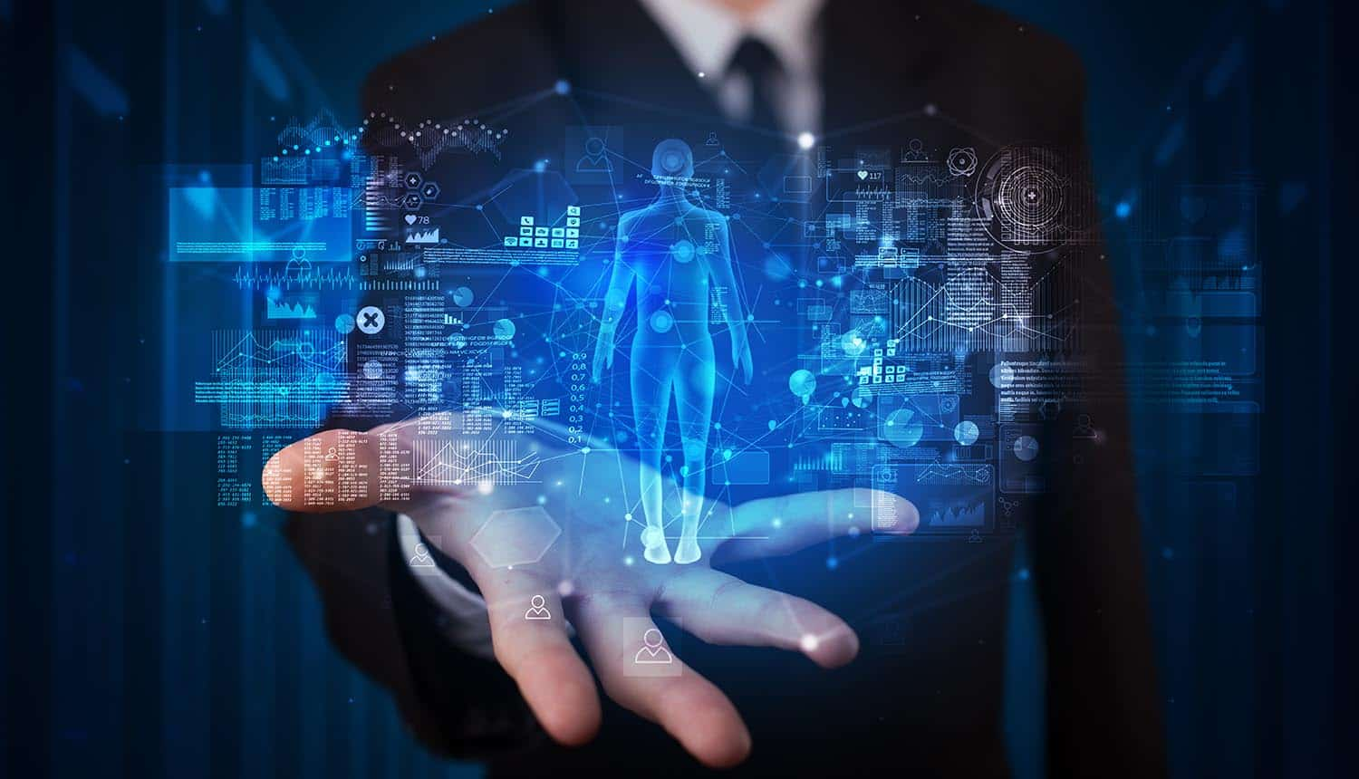 Man holding hologram projection displaying health related graphs and symbols showing use of artificial intelligence in healthcare
