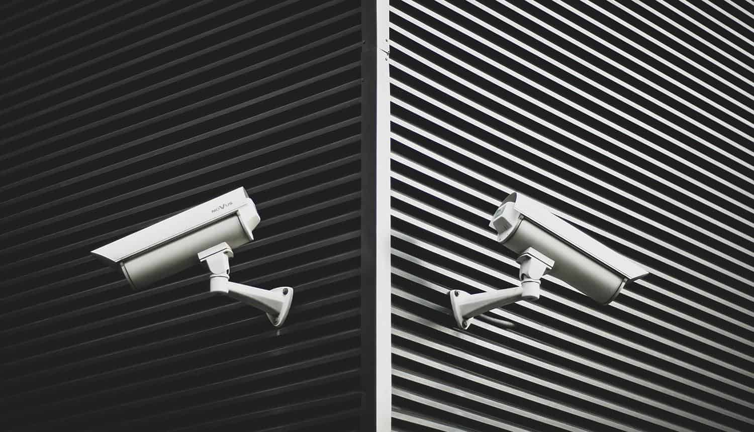 Surveillance cameras on a wall