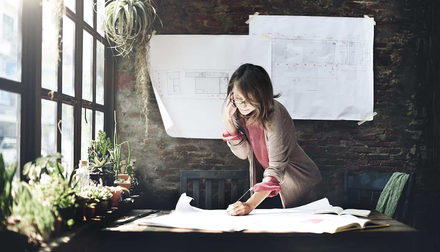 Woman working on blue print showing data privacy trends in 2021
