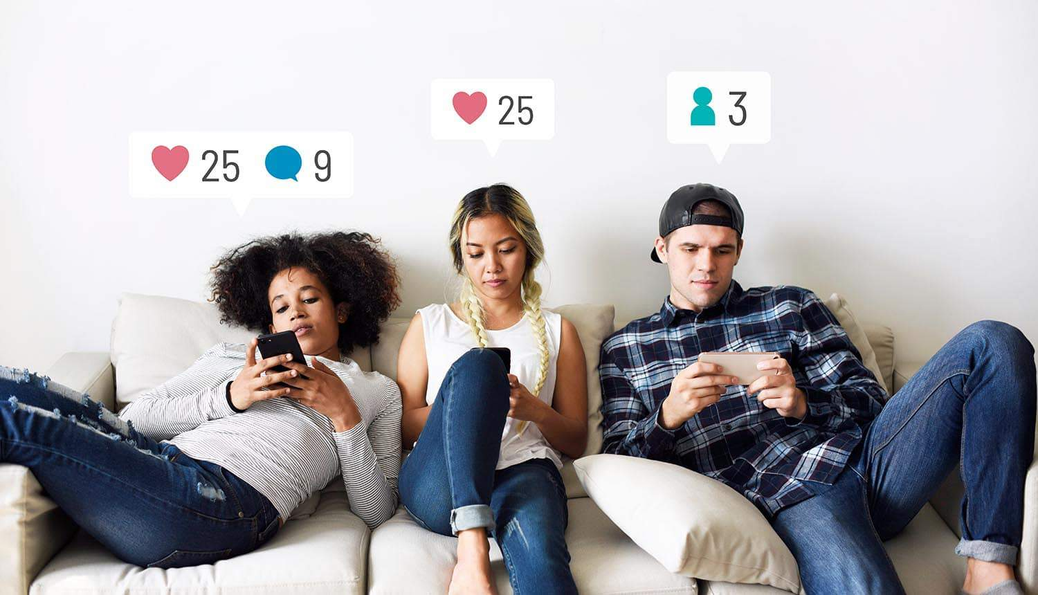 Young adults on the couch using smartphones showing privacy policy update for WhatsApp