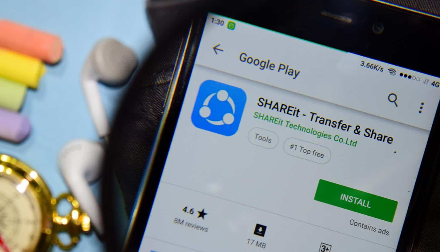 SHAREit app with magnifying on smartphone screen showing file-sharing app security flaw