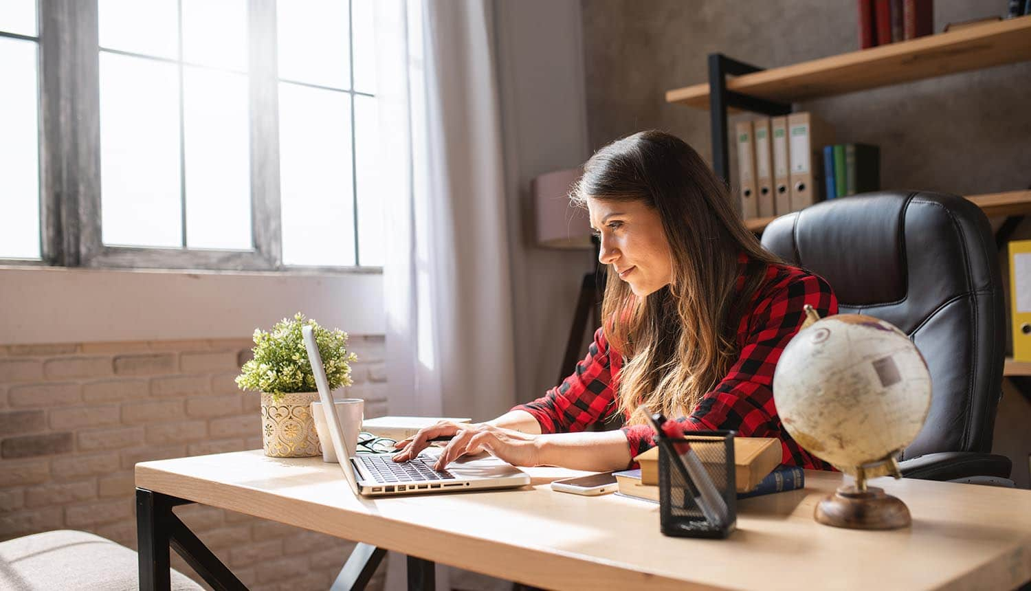 Girl teleworker works at home with a laptop using video conferencing platform