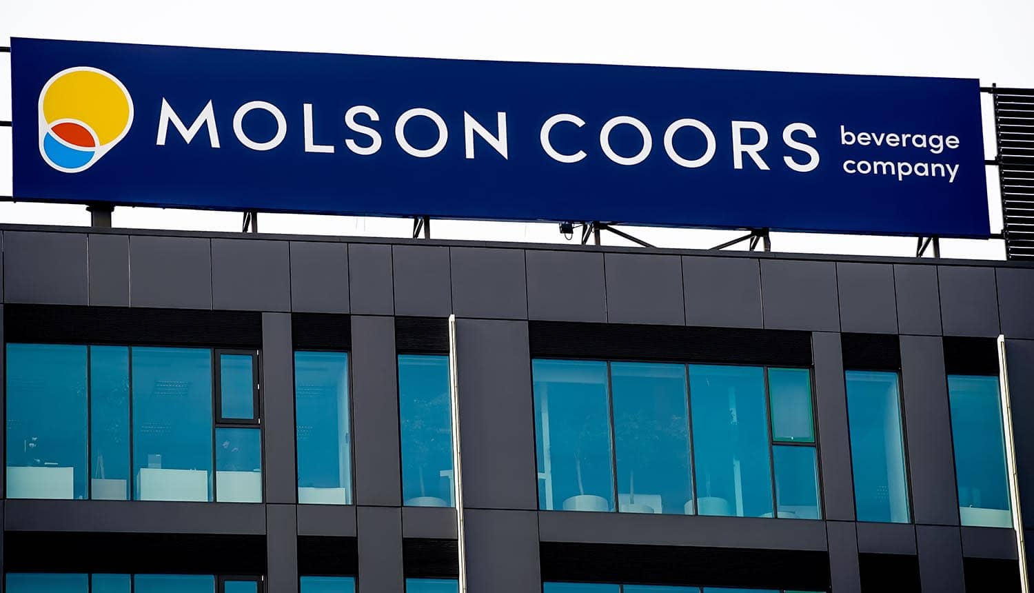 Logo of Molson Coors displayed on the top of a building showing cyber attack