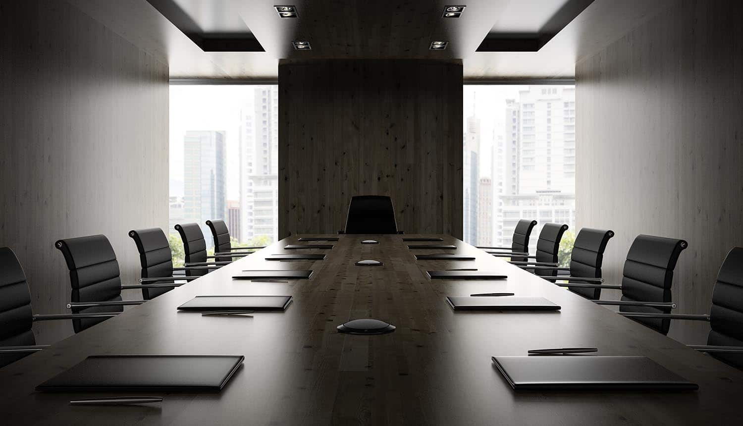 Interior of modern boardroom with black armchairs showing executive commitment and cyber complacency