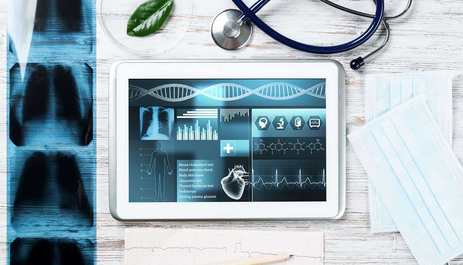 Tablet computer with medical diagnostics showing ransomware attacks responsible for healthcare data breaches