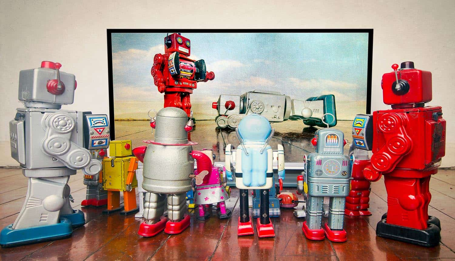 Retro robots watch bots on TV showing increase in marketing fraud