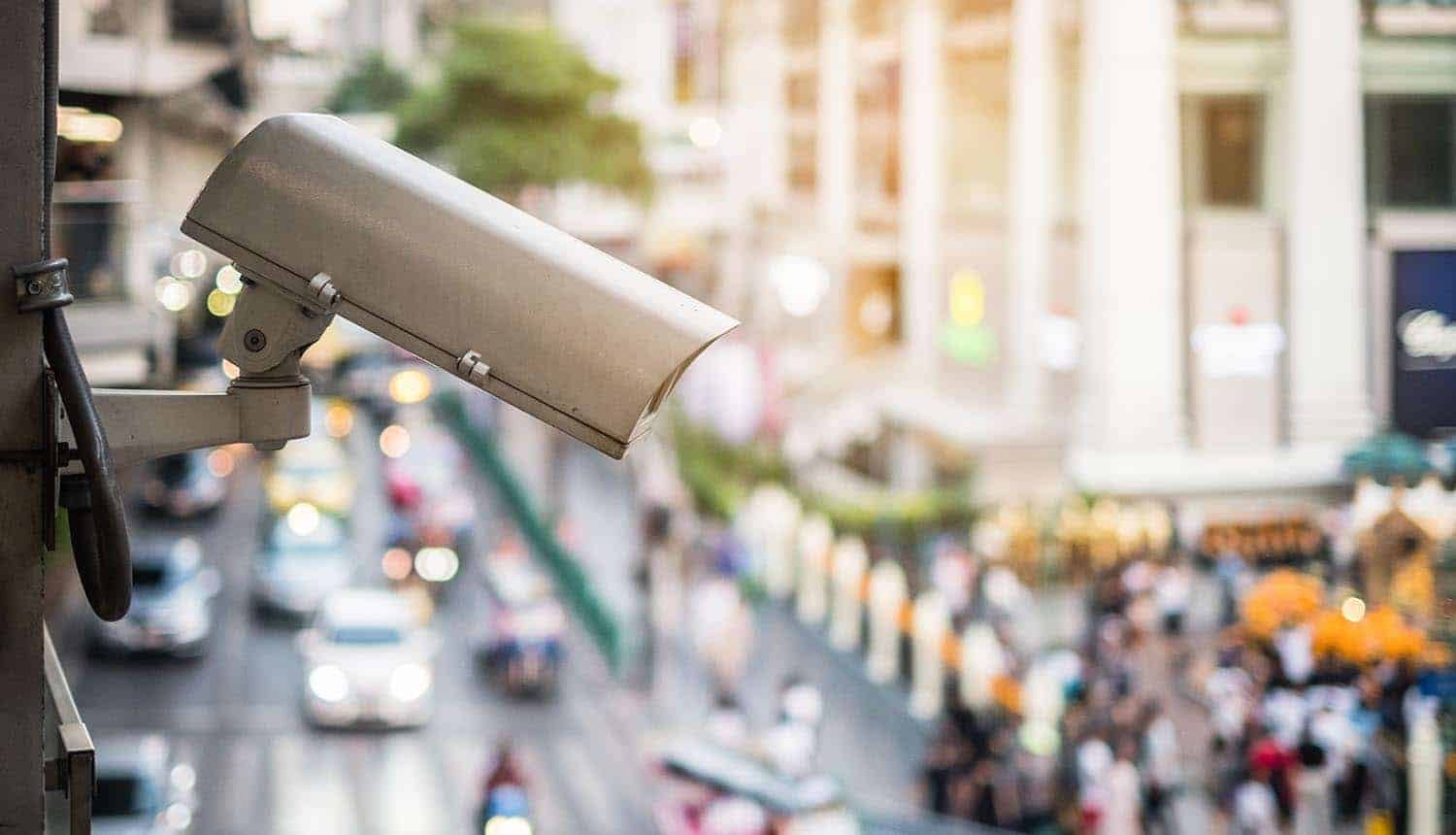 Closeup of security surveillance cameras on the road in the big city showing data breach and facial recognition issues