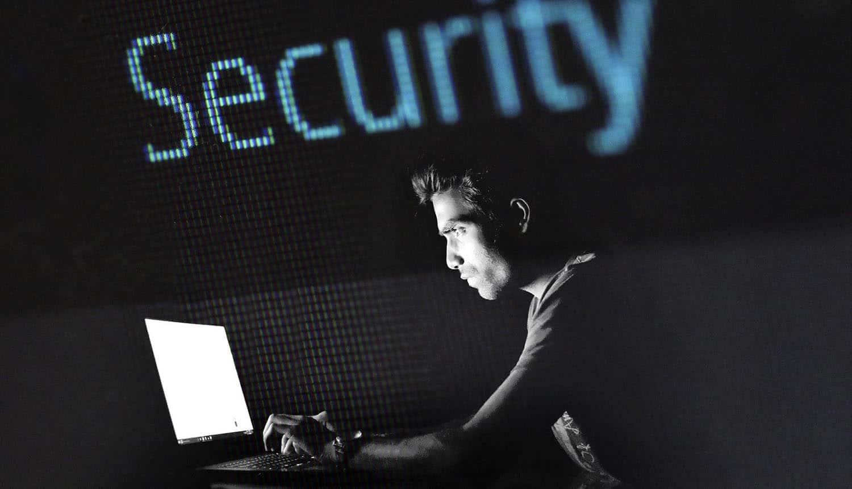 Hacker working on laptop