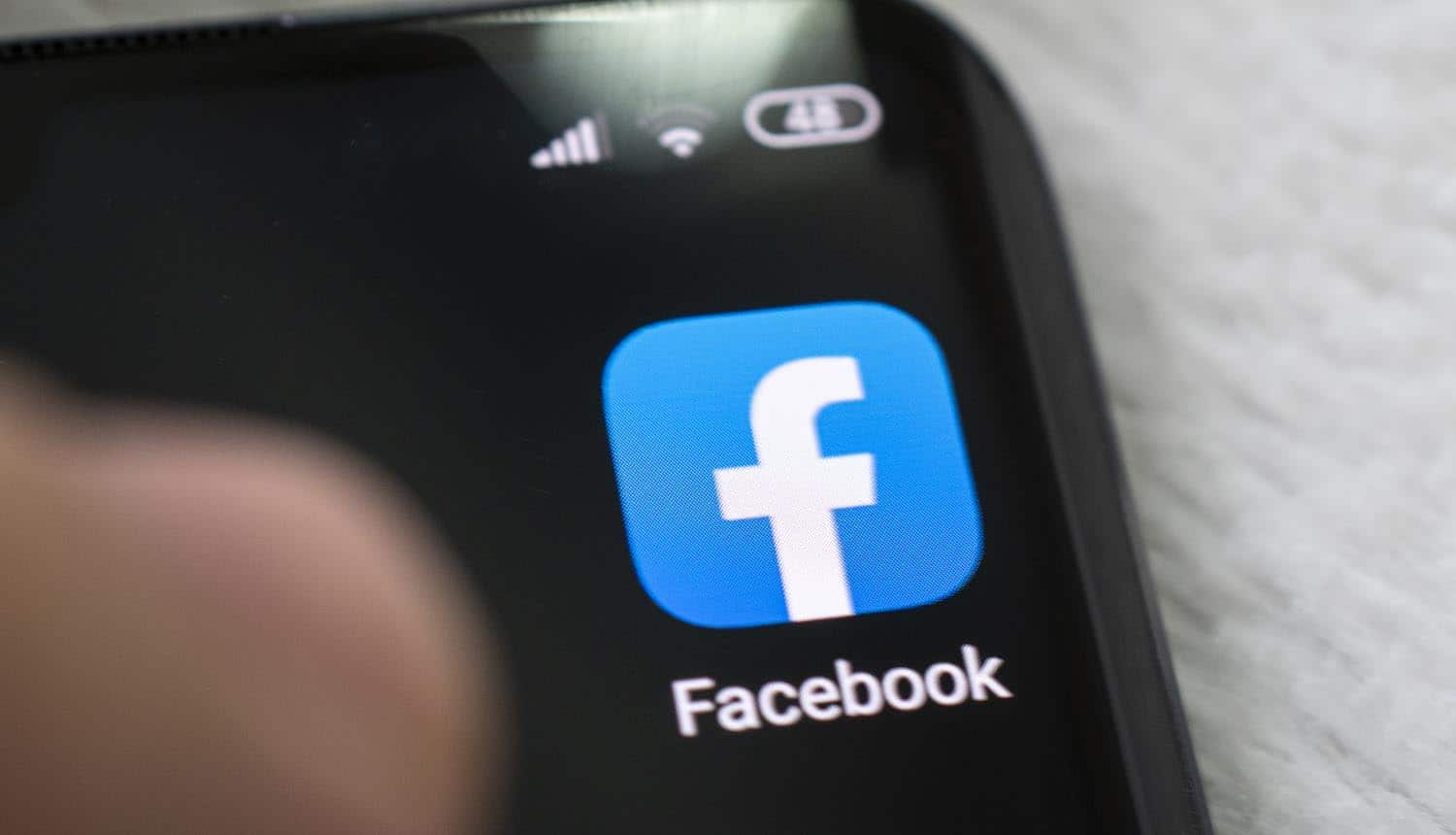 Facebook mobile app on phone screen showing legal action on data leak