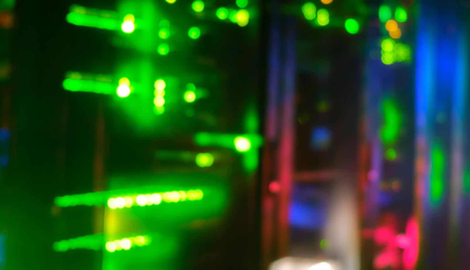 Blurred background of server hardware showing takedown of web shells on compromised Microsoft Exchange servers
