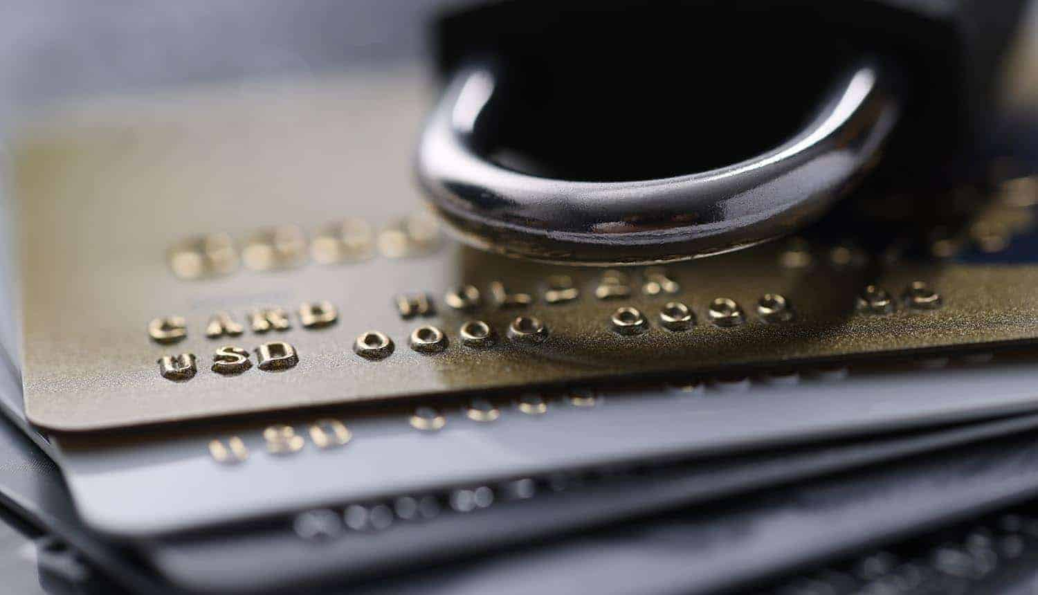 Credit cards with a lock showing data breach at carding site