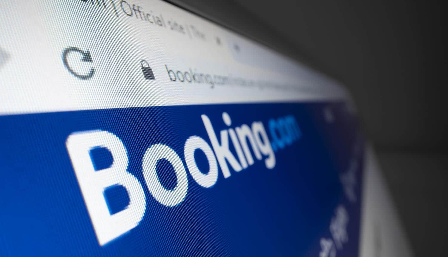 Close-up view of Booking.com logo on its website showing fine due to late data breach notification
