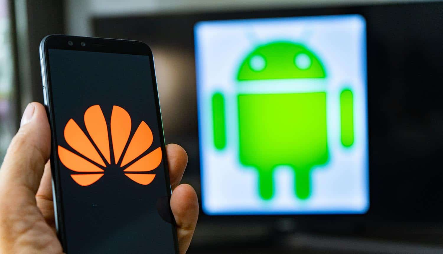 Man holding Android phone with Huawei logo in front of the Android logo showing spread of Joker malware