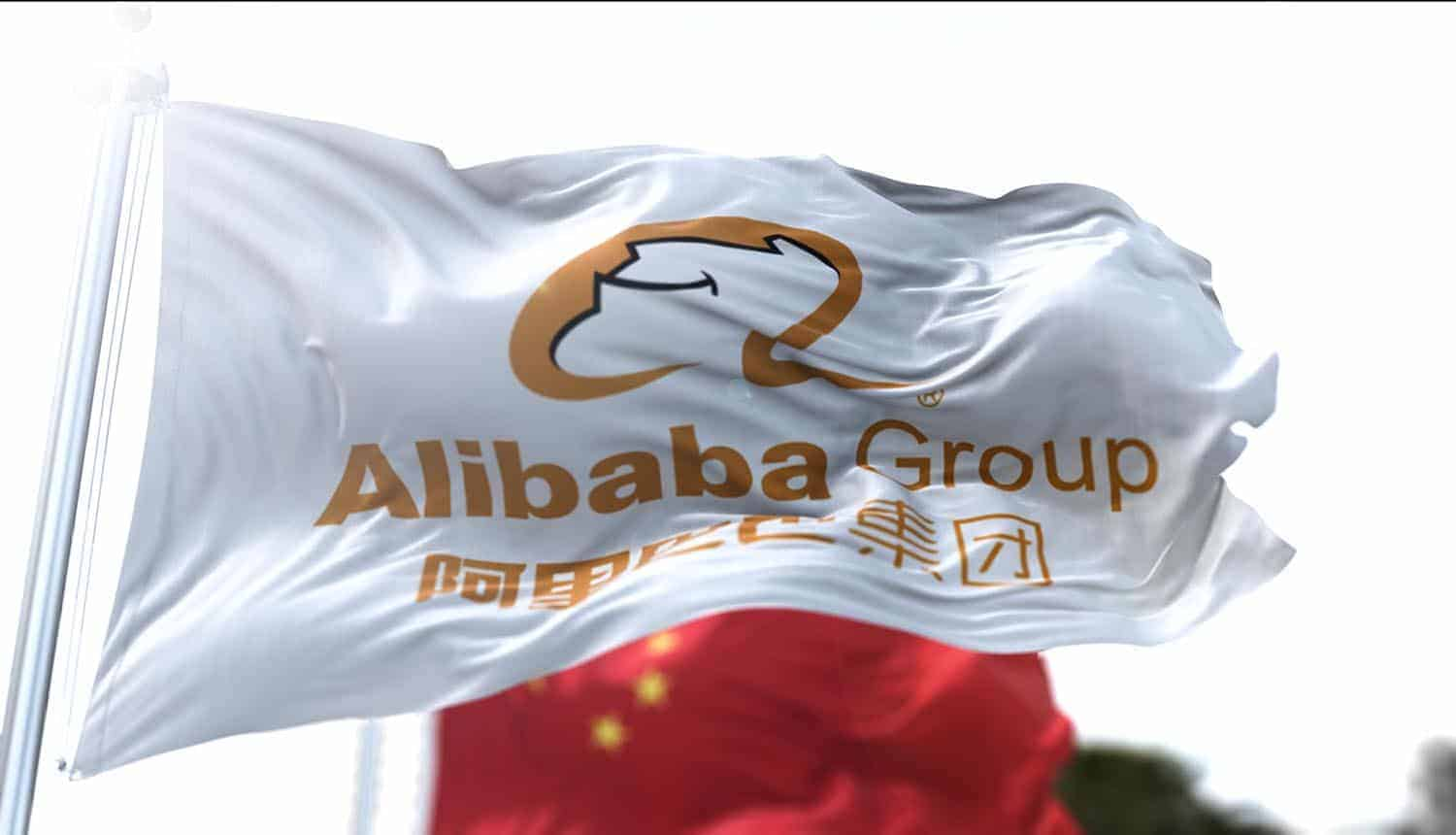Flag with the Alibaba Group logo flying along with the national flag of China showing data protection rules aimed at tech giants