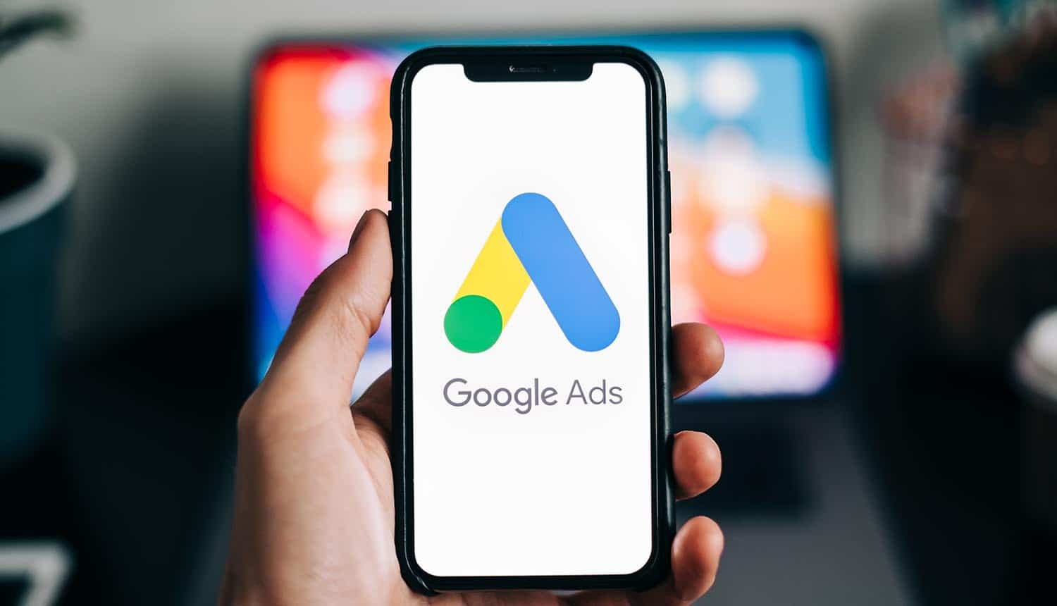 Google Ads logo on smartphone screen showing national security concern over ad auctions of ad exchanges